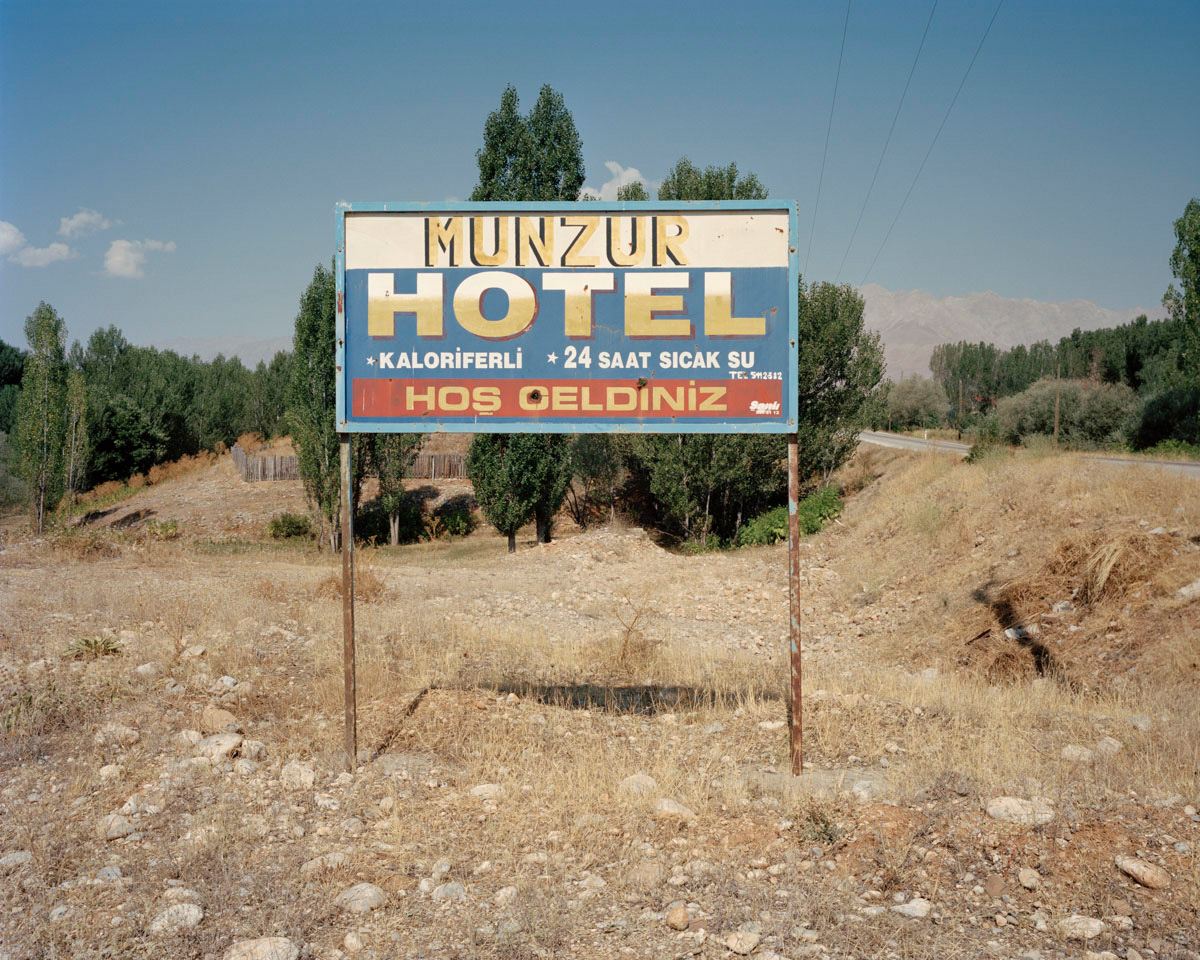 A hotel sign in the Munzur valley with bullet holes is a reminder of past fights between guerrilla groups and the military