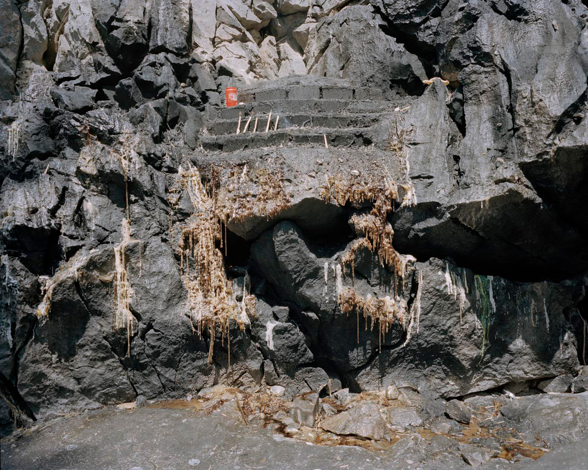 An altar next to the Munzur springs, a pilgrimage site for Alevi people, is covered with wax