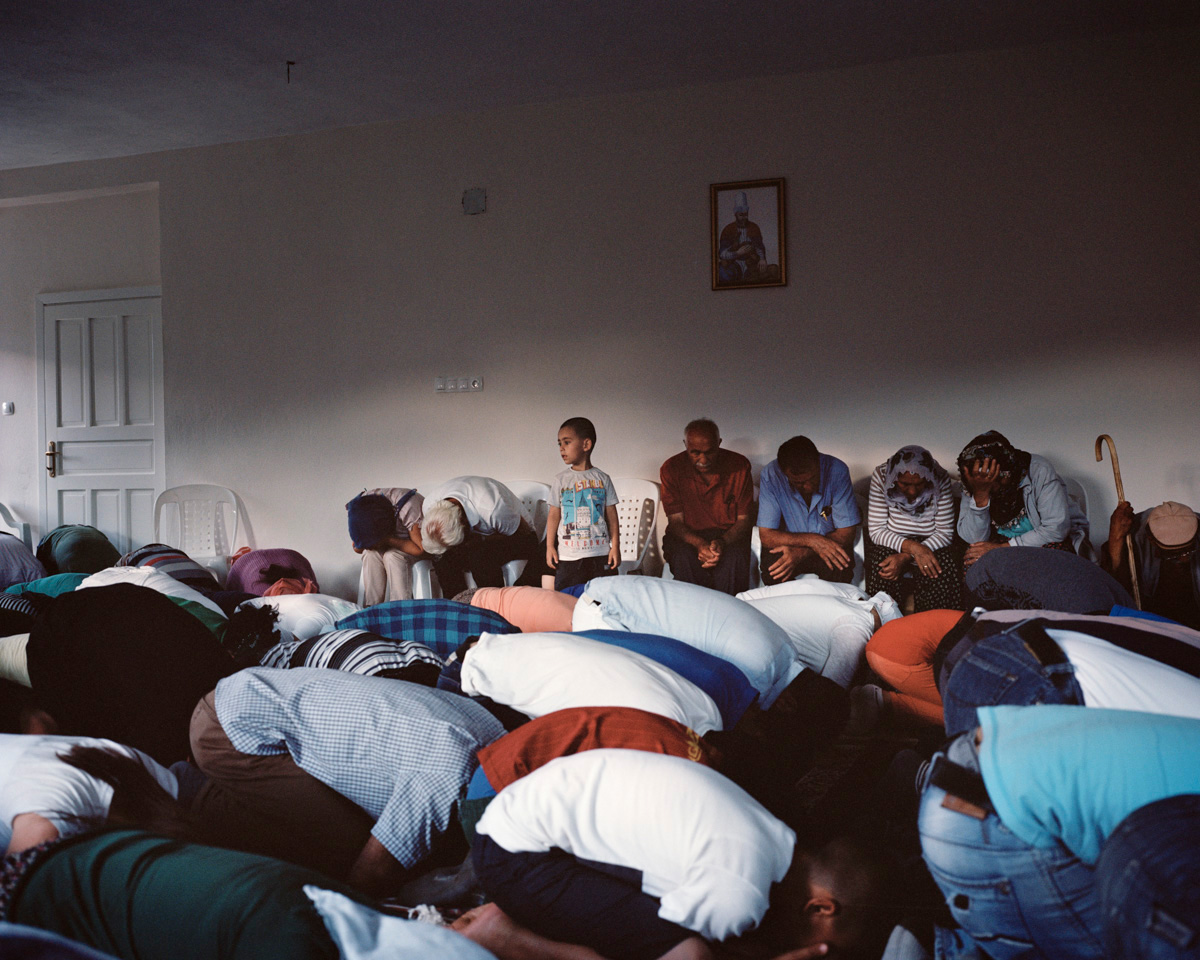 Alevis are praying during a Cem, a holy gathering