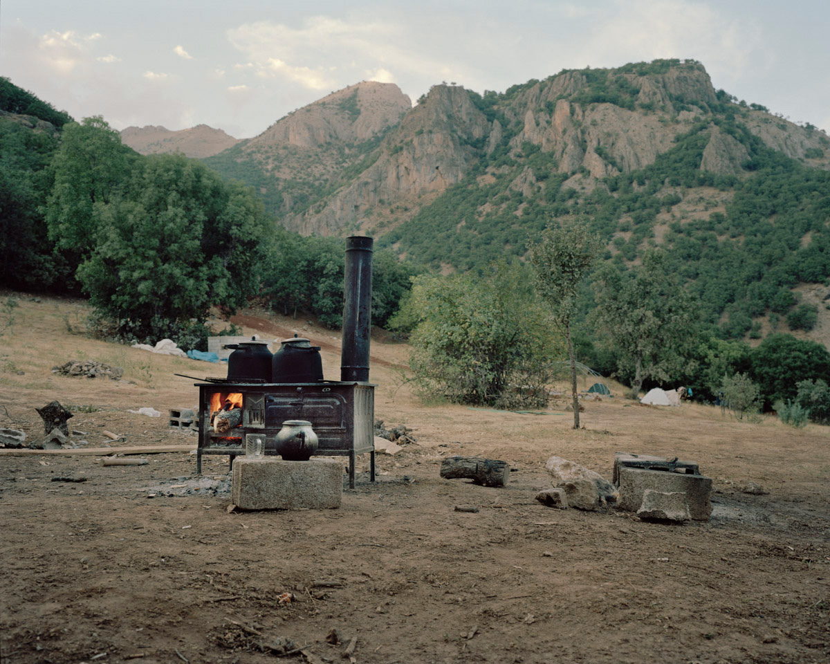 Fire is burning in a tea stove placed in a temporary guerrilla camp around Dersim